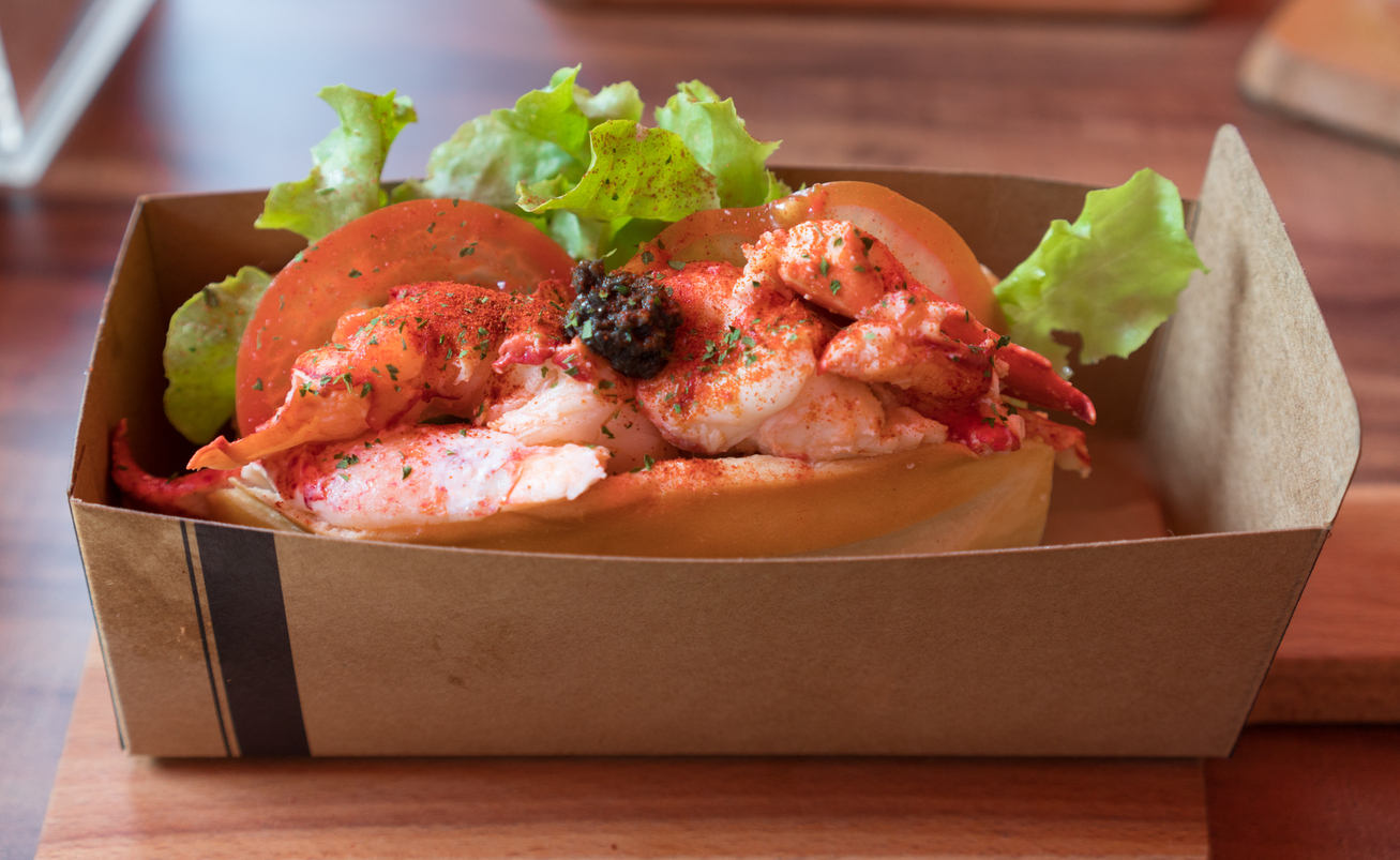 Lobster roll sandwich to go with salad tomatoes and black truffle