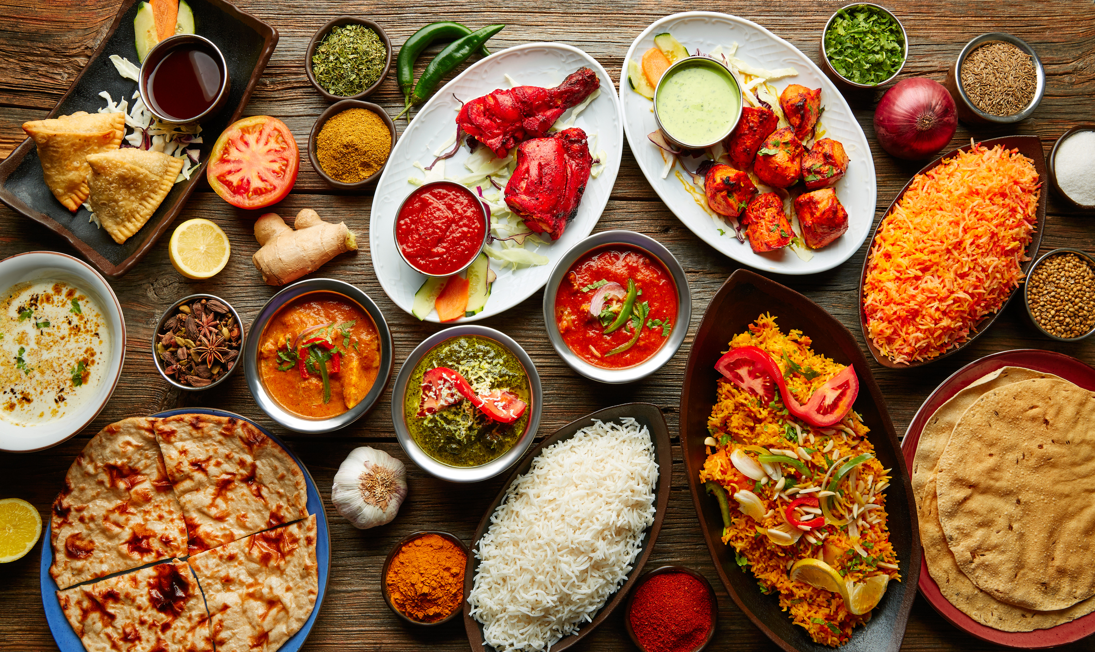 Assorted Indian food and dishes served on a dinner table - Indian food in Hanover