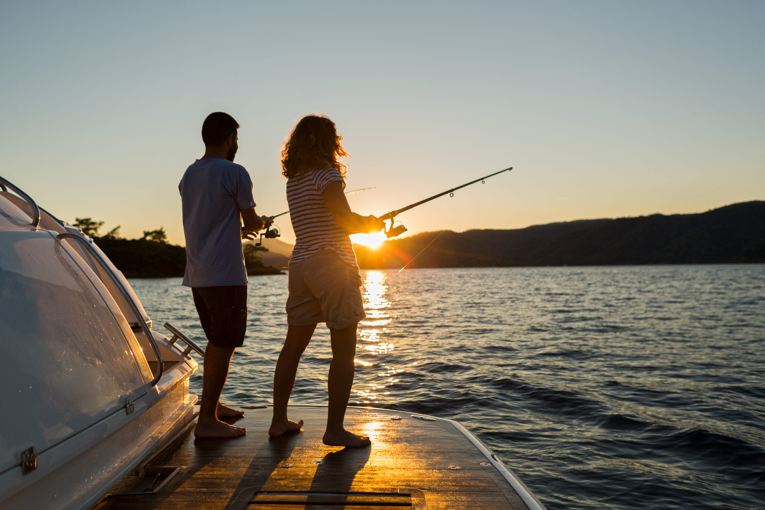 Young couple fishing at sunset | fishing spots in Anne Arundel County