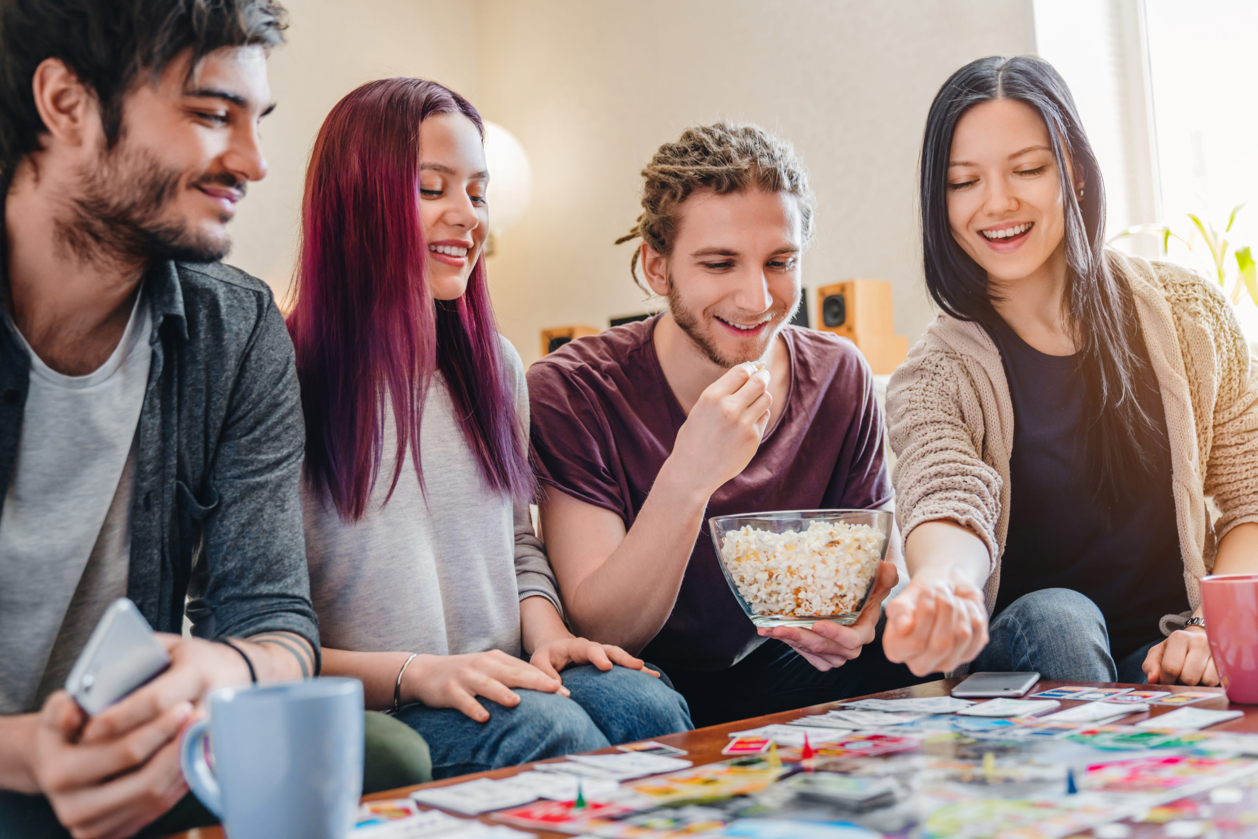 Young people playing board games together | tabletop game stores in Hanover, MD