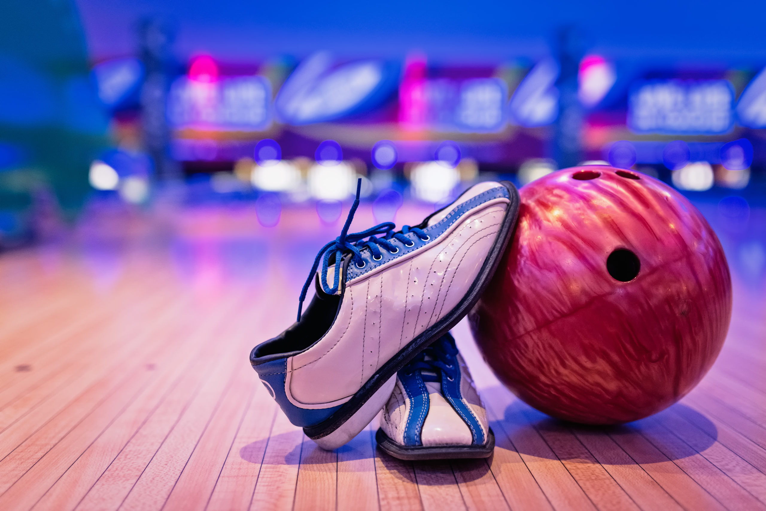 Bowling shoes and ball in front of a bowling lane | bowling alleys in Hanover, MD