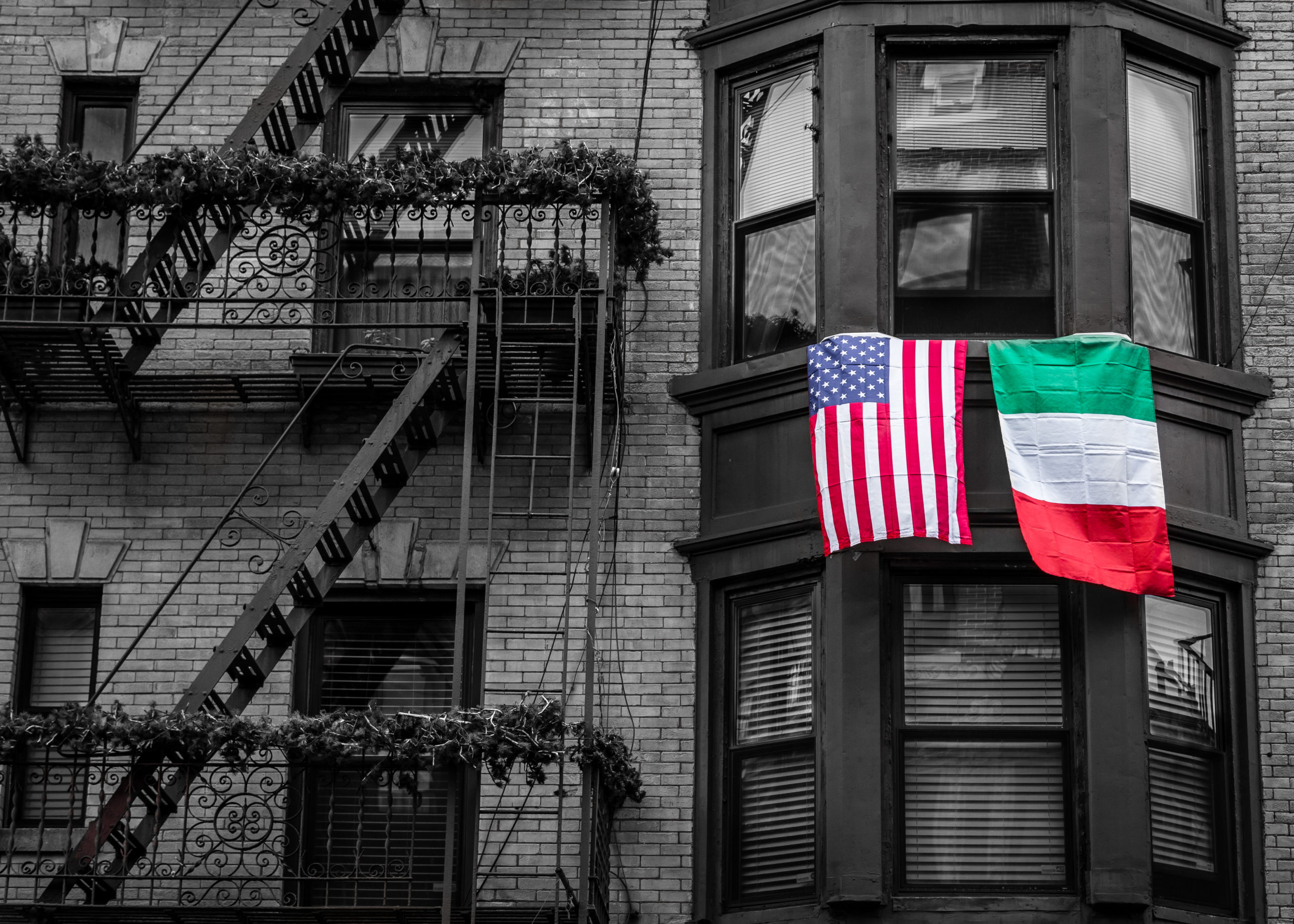 American and Italian flags flying side by side | Little Italy in Baltimore, MD